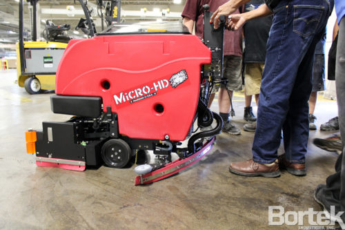 Factory Cat Micro-HD floor scrubber in use