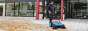 Hammerhead 950MS Sweeping Leaves on Sidewalk walkway in front of Office Building