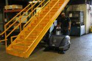hammerhead-900sx-walk-behind-battery-powered-sweeper-industrial-setting