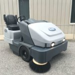 Pre-owned Used Advance Exterra 6340LP-Rider Sweeper- Propane Powered-New Model is the SW8000- Front Main Image